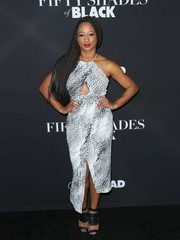 Monique Coleman looked foxy at the 'Fifty Shades of Black' premiere in a monochrome halter dress with peekaboo detailing.