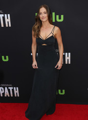 Minka Kelly vamped it up at the premiere of 'The Path' in a black L'Agence maxi dress with a midriff cutout and a strappy neckline.