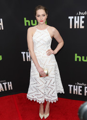 Amy Forsyth looked fab at the premiere of 'The Path' in a white halter dress rendered entirely in triangular eyelets.