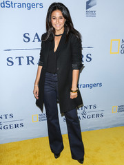 Emmanuelle Chriqui teamed her jeans with a sleek black coat for a more stylish finish.