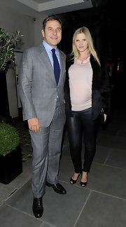 Lara Stone gave her dinner look a little edge with black leather leggings.