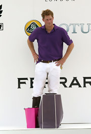 Prince Harry wore a purple polo shirt for the celebrity polo match.