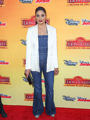 Rachel Roy wore a denim jumpsuit for a fun look on the red carpet when paired with a chic white blazer.