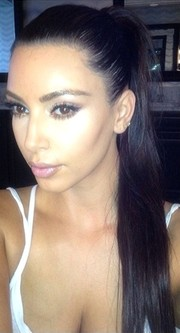 Kim Kardashian looked like a shampoo model with her sleek ponytail.