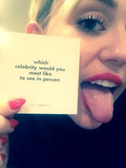Miley Cyrus showed off a perfect red mani in this social media pic.