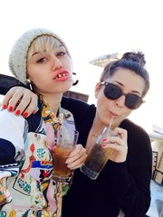 Miley Cyrus hammed it up wearing a knit beanie and some hideous dentures in this social media pic.