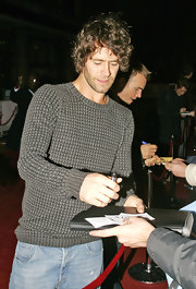 Howard Donald's patterned gray crewneck sweater and tousled hair gave him a boyish aura.