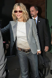 While making her way out of the GMA studios, Meg showed off her metallic grey blazer.