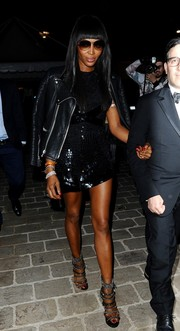 Naomi Campbell completed her fierce outfit with chain-embellished strappy sandals.