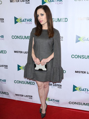 Zoe Lister Jones styled her dress with a modern black-and-white box clutch.