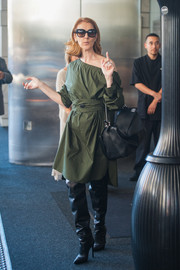 Celine Dion stepped out of the Ritz looking cool in a military-green off-one-shoulder dress.