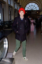 The actor wore a bright red beanie with a pea coat while arriving in the cool winter weather.