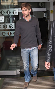 Chace paired his distressed jeans with a pull over hoodie.
