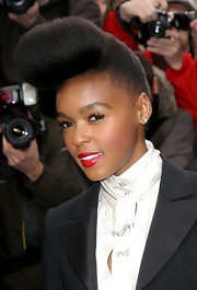 Singer Janelle Monae rocked her signature pompadour at the Chanel Haute Couture fashion show. Silky red lips finished off her look.