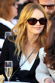 Vanessa Paradis is all smiles in the sun, with this pair of stylish butterfly shaped sunglasses.
