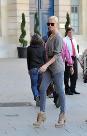 Charlize Theron looked casually stunning in a chic pair of nude leather multi-buckle ankle boots.