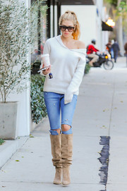Charlotte McKinney paired her sweater with torn skinny jeans.