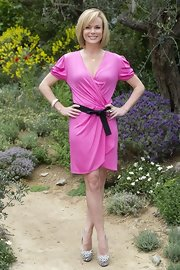 Amanda Holden glowed in a bright pink wrap dress at the Chelsea Flower Show press day.