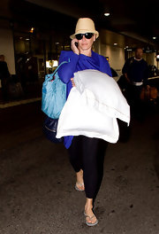 Chelsea Lately made her way through LAX in a pair of silver flip flops.
