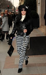 Cher was a head turner in Paris in her harlequin pants and leather jacket combo.