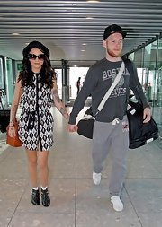 Cher Lloyd looked playful yet funky in this patterned shirt dress at the airport.