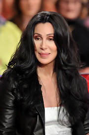 Cher looked beautiful at a French TV interview. Her layered curls added depth and volume to her look.