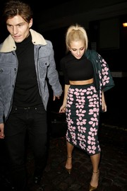 Pixie Lott teamed her suit with a sexy black crop-top by Topshop.