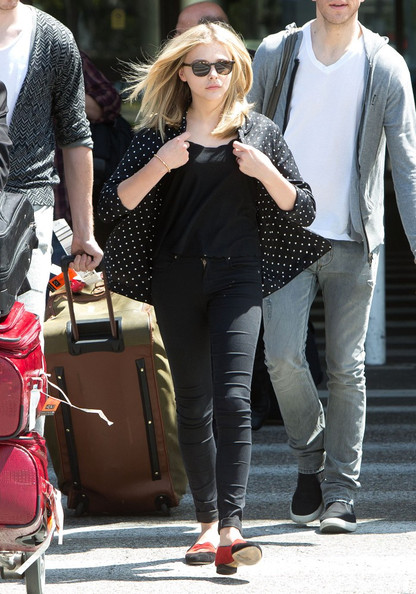 Chloe Moretz where's some dark attire as she arrives at LAX (Los
