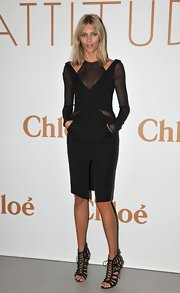 Anja Rubik looked supremely avant garde in her black dress with cool cutouts and mesh insets.