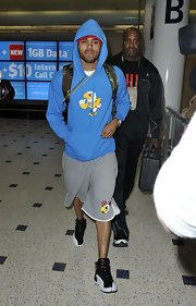 Chris Brown wore his trademark basketball sneakers as he touched down at Sydney's airport.