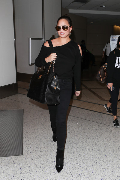 For her travel bag, Chrissy Teigen chose an oversized satchel by Chanel.