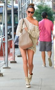 Chrissy Teigen kept the neutral theme going with a cross-body tote featuring a studded bottom.