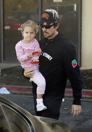 Actor Christian Bale supports USC with this blue baseball cap.
