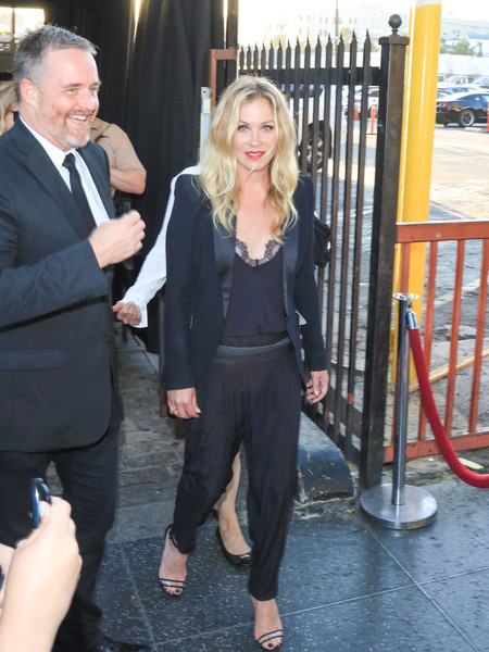 Christina Applegate accessorized her outfit with a pair of trendy PVC sandals.