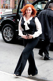 Christina Hendricks looked polished wearing this ascot blouse with a black sweater vest.