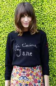 Alexa Chung was a doll at the British Designers Collective launch in this charming black sweater and brocade floral skirt.
