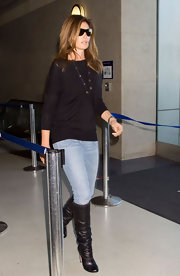 The always current Cindy Crawford shows off these edgy studded leather boots. Even when at the airport cindy always looks stylish.