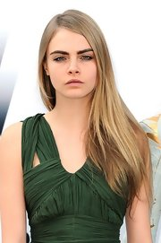 Cara Delevingne arrived at the amfAR Gala wearing her lightened tresses in a long straight style.