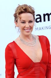 Kylie Minogue arrived at the amfAR Cinema Against AIDS event wearing a shimmering triple strand white diamond necklace.