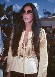 Cher rocked a pair of oversized embellished sunglasses in one of her old photos.