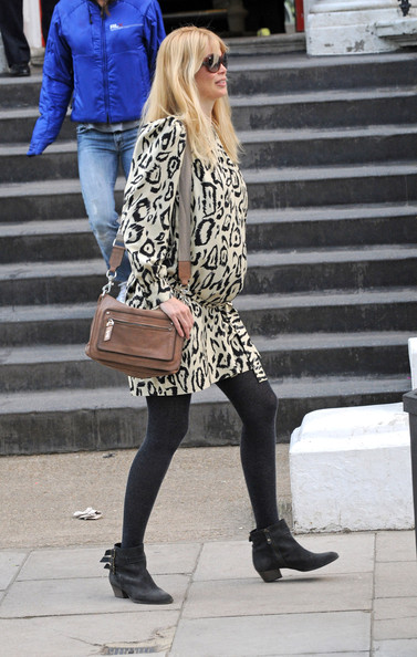 A very pregnant claudia showed off her stylish duds while dropping her son Casper at school. She paired her printed tunic with a leather shoulder bag.