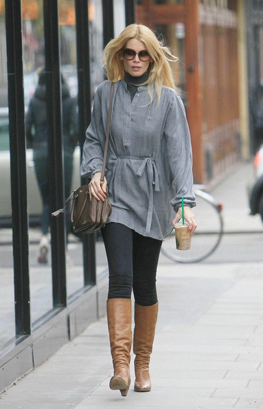 Claudia wears a soft chambray tunic over leggings while out in Notting Hill for coffee.