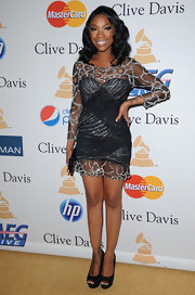 Brandy sparkled in a mini dress at Clive Davis' Grammy bash. She wore a long-sleeved frock with a draped bodice and beaded cobweb-print accents.