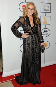 Anastacia donned a lovely black sheer-overlay gown with floral beading for Clive Davis' pre-Grammy gala.