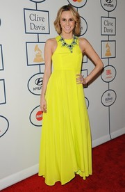 Keltie Knight lightened up Clive Davis' pre-Grammy gala with her bright yellow gown.