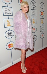Miley Cyrus looked relatively tame in a lavender Calvin Klein fur coat during Clive Davis' pre-Grammy gala.