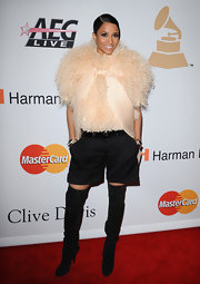 While attending Clive Davis's Grammy party, Ciara donned a pair of suede over-the-knee boots and some type of furry embellished top. We like the boots but, are not quite sure what's goin' on with her shirt.