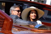 Amal Alamuddin enjoyed a Venice boat ride looking chic in a white wide-brimmed hat.
