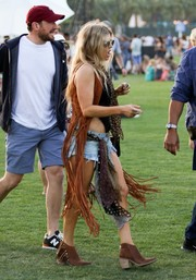 Fergie came appropriately fringed in a brown Alberta Ferretti vest during day 1 of Coachella.