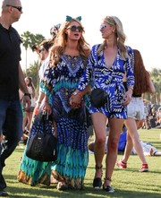 Paris Hilton showed her love for bold, eye-catching prints with this colorful muumuu during day 2 of Coachella.